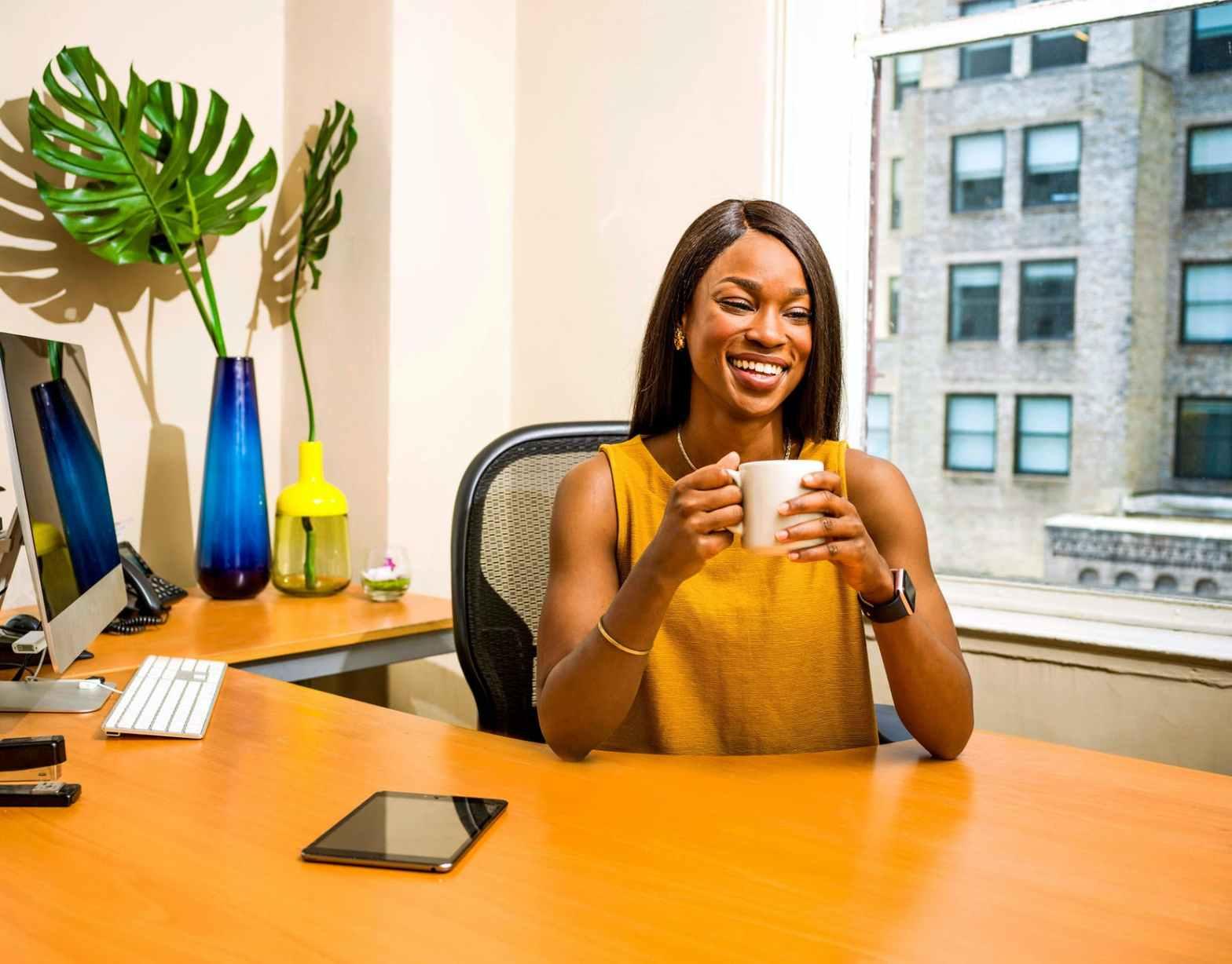 women sitting behind desk